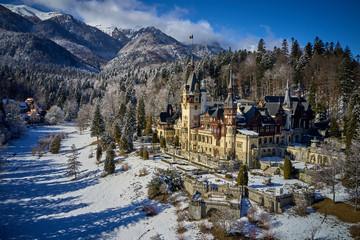 Photo sur Aluminium Aerial drone view of a beautiful Peles castle in Sinaia in the winter season, Transylvania, Romania