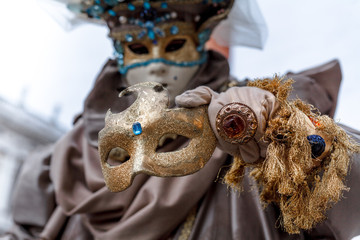 Close-up of a costume reveller poses during the Carnival in Venice, Italy