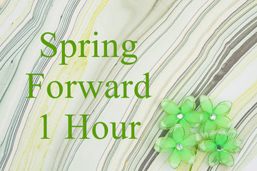 Spring forward 1 hour message with green flowers on watercolor paper