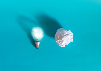 Concept of bright idea with paper and light bulbs