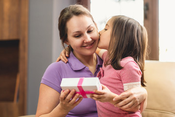 Happy Mother's Day Celebrating Concept. Child Daughter Giving Present to Her Mom.