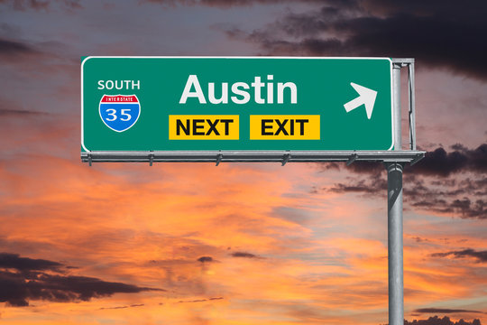 Austin Texas route 35 freeway next exit sign with sunset sky.
