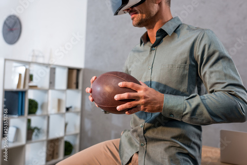 cropped view of smiling businessman wearing virtual reality headset
