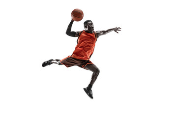 Full length portrait of a basketball player with a ball isolated on white studio background. advertising concept. Fit african anerican athlete jumping with ball. Motion, activity, movement concepts.
