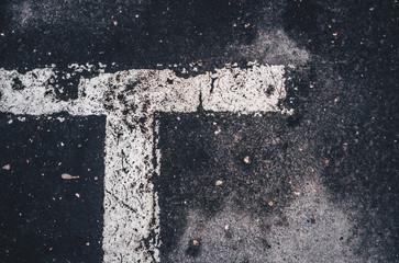 white markings on asphalt