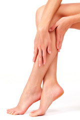 Beautiful long female legs, unwanted hair removal concept. Skin care. White background
