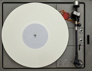 Vintage vinyl turntable with vinyl plate. Listen to music. Top view.