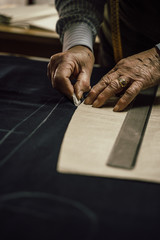 Craftsman tailor at work in the workshop