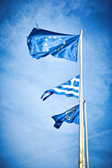 Flags , EU, Greece waving in the wind against the sky