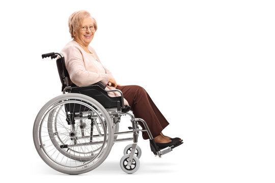 Senior woman in a wheelchair smiling at the camera
