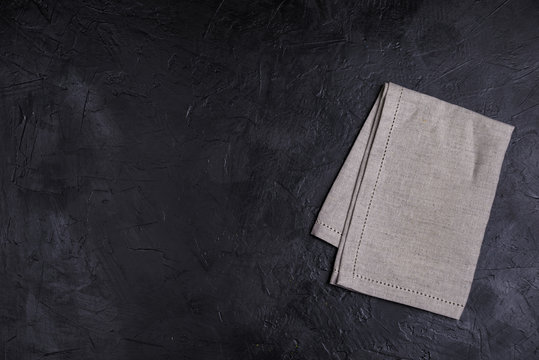 Business lunch, Table place setting with linen napkin on black color background, banner, top view, copy space