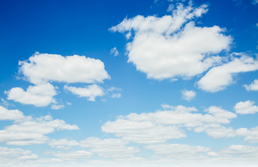 Fantastic view of the azure sky on a sunny day with fluffy clouds.