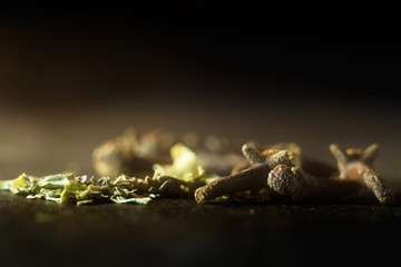 macro photo spices on the table dark background