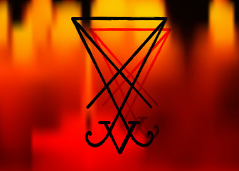 A sigil of Lucifer. Grunge styled distressed demonology vector illustration: Lucifer sigil isolated or fire background. Satan Devil Lucifer sigil with reversed pentagram