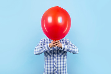man with a red balloon on a blue background