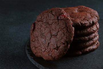 chocolate cookies on dark background. brownie cookies stack