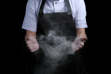 hand clap of chef with flour on black background isolated