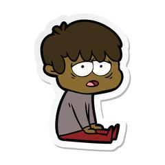 sticker of a cartoon exhausted boy