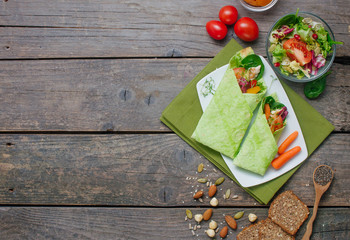 Sandwiches, salad, nuts, crispbreads and chia seeds on rustic wooden background