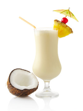Pina colada cocktail with coconut on white background
