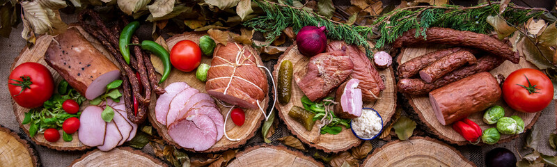 Assortment of cold meats: sausages, ham, bacon