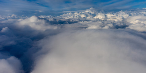 View from the sky, cloud, a plane flying through a cloudy sky