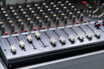 Amplifier mixer and equalizer in studio room in close up view.