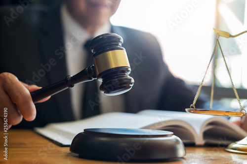 Male lawyer working with contract papers and reading law