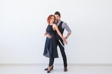 Social dance, kizomba, tango, salsa, people concept - beautiful couple dancing bachata on white...