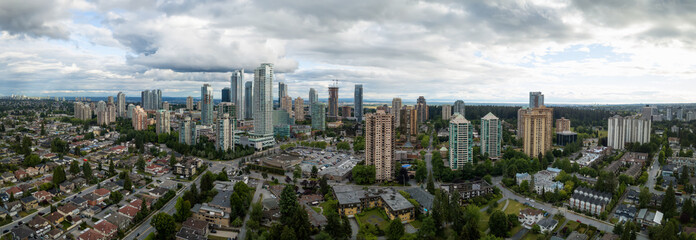 Aerial Panoramic view of residential homes in a modern city during a vibrant summer cloudy day. Taken in Burnaby, Vancouver, BC, Canada.