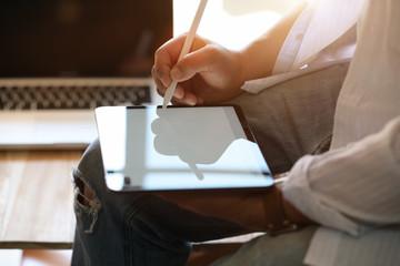 Male designer draw sketching on modern digital tablet