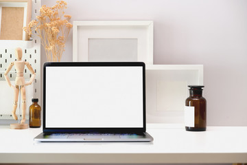 Blank screen mock up laptop on minimal workspace