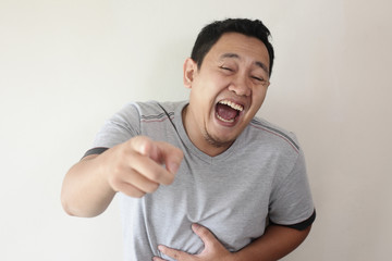 Man laughing Hard Bully Expression and Pointing Forward