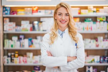 Medicine, pharmaceutics, healthcare and people concept. Portrait of a happy female pharmacist.