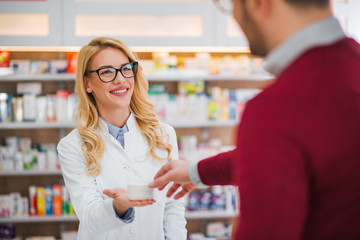Pharmacist and customer in a drugstore.