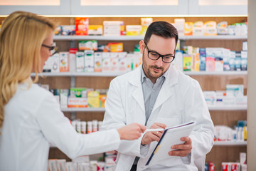 Two pharmacists at work.