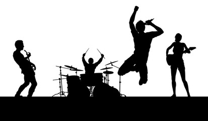 A musical group or rock band playing a concert in silhouette Fotomurales