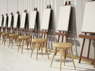 Easels and blank canvases standing in a row. 3D illustration