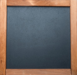 Blackboard with wooden frame. Close-up.