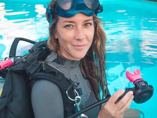 Working mum, super mum. PADI Scuba  Diving Woman with equipment  in the poolside Wall mural