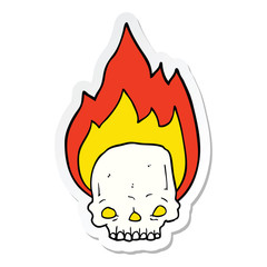 sticker of a spooky cartoon flaming skull