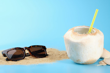 Aluminium Prints Carnaval Summer concept. Coconut juice and sunglasses on the sand