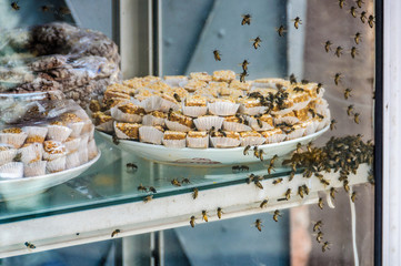 Bees in local sweet in Marrakech, Morocco