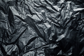 black crumpled plastic bag
