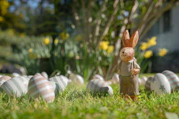Happy Easter, Easter painted eggs and esater rabbit sitting in green grass