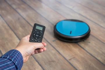 Holding robot vacuum cleaner remote control control