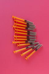 Syringe Pink Background