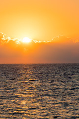 Colorful dawn over the sea, Sunset. Beautiful magic sunset over the sea. vertical photo