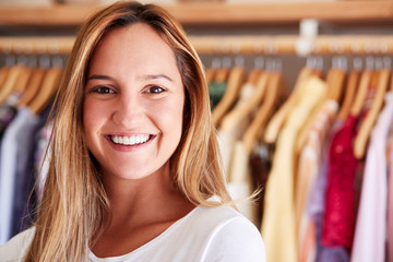 Portrait Of Female Customer Or Owner Standing By Racks Of Clothes In Independent Fashion Store Wall mural