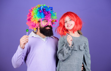 Having the best day ever. Happy birthday. Father and daughter in party style wigs. Happy family celebrating birthday. Father and girl child enjoying birthday celebration. Birthday party